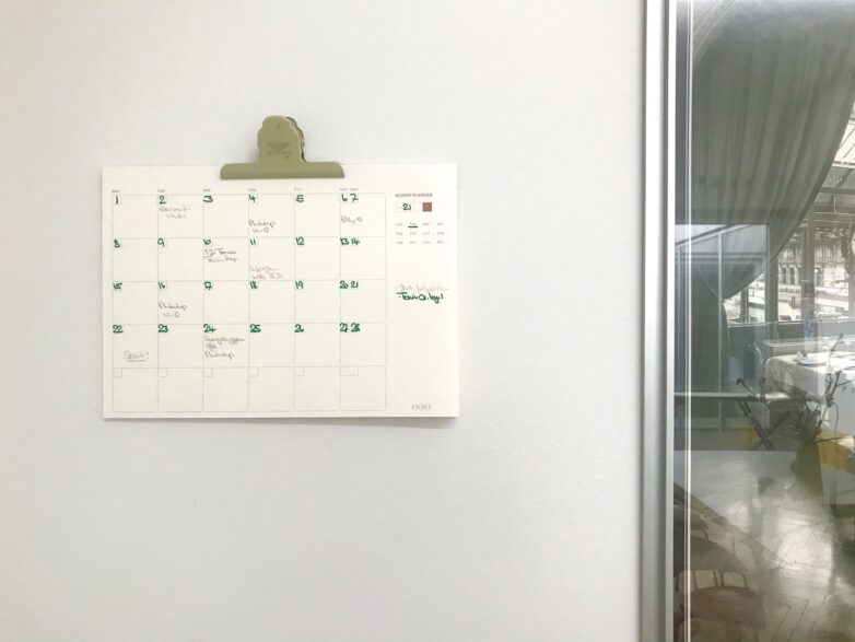 Etiket Month Planner hanging on the wall