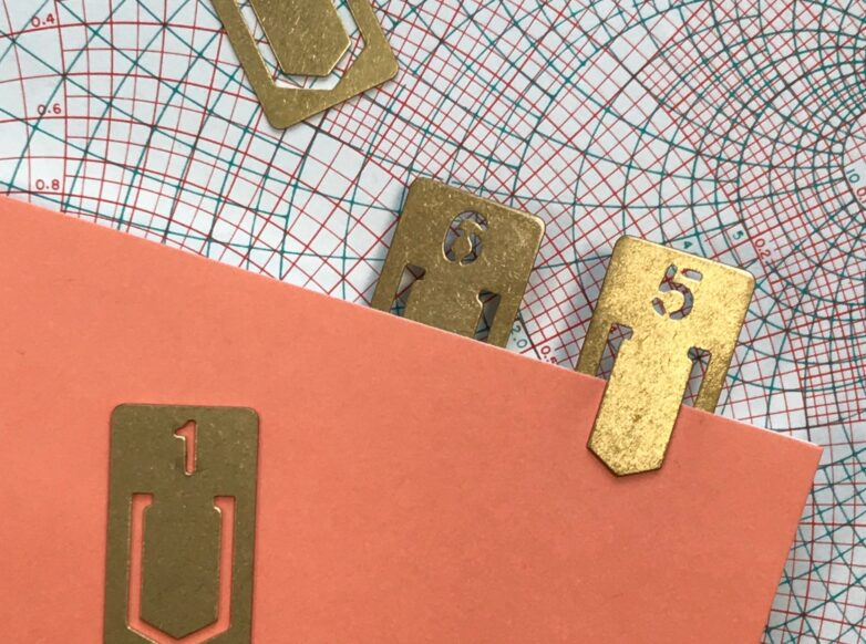 Brass Number Clips in use