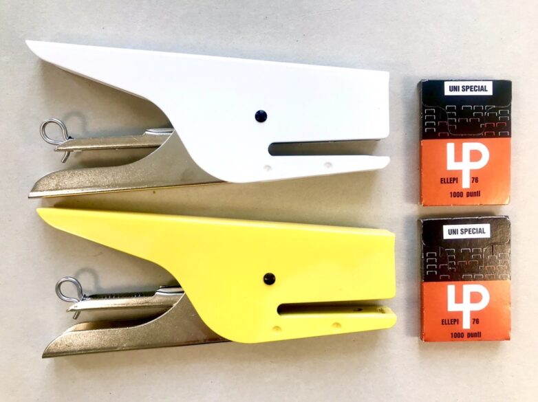 Klizia Stapler white and yellow and a box of staplers