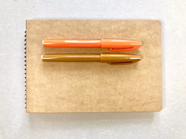 Notebook with envelopes back