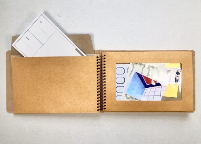 Notebook with envelopes open and in use