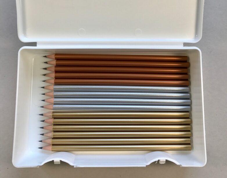 Shiny pencil in white box