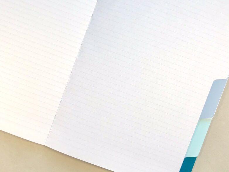 Tap Notebook opened flat, inside grid