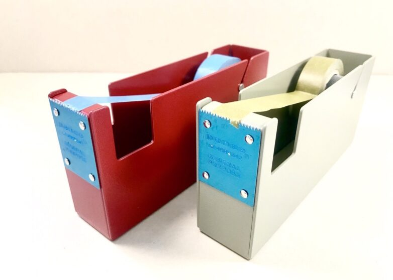 Tape dispenser in red and ivory front view